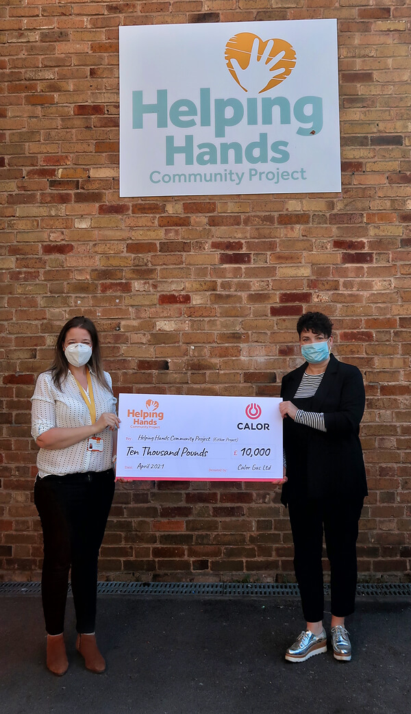 Calor colleague handing over big cheque worth £10k