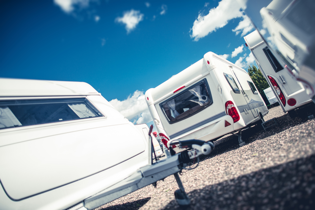 Several white caravans in a caravan park