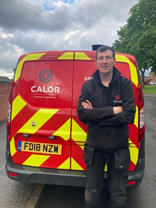 Calor Engineer standing in front of a Calor van