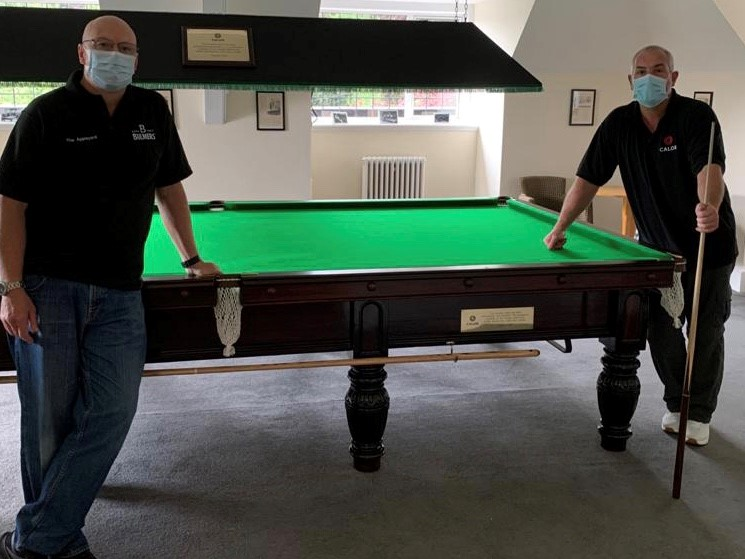 Calor Employees who refurbished the Snooker table standing by the table