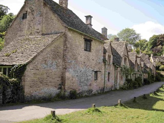 A rural, stone built row of houses in the coutryside