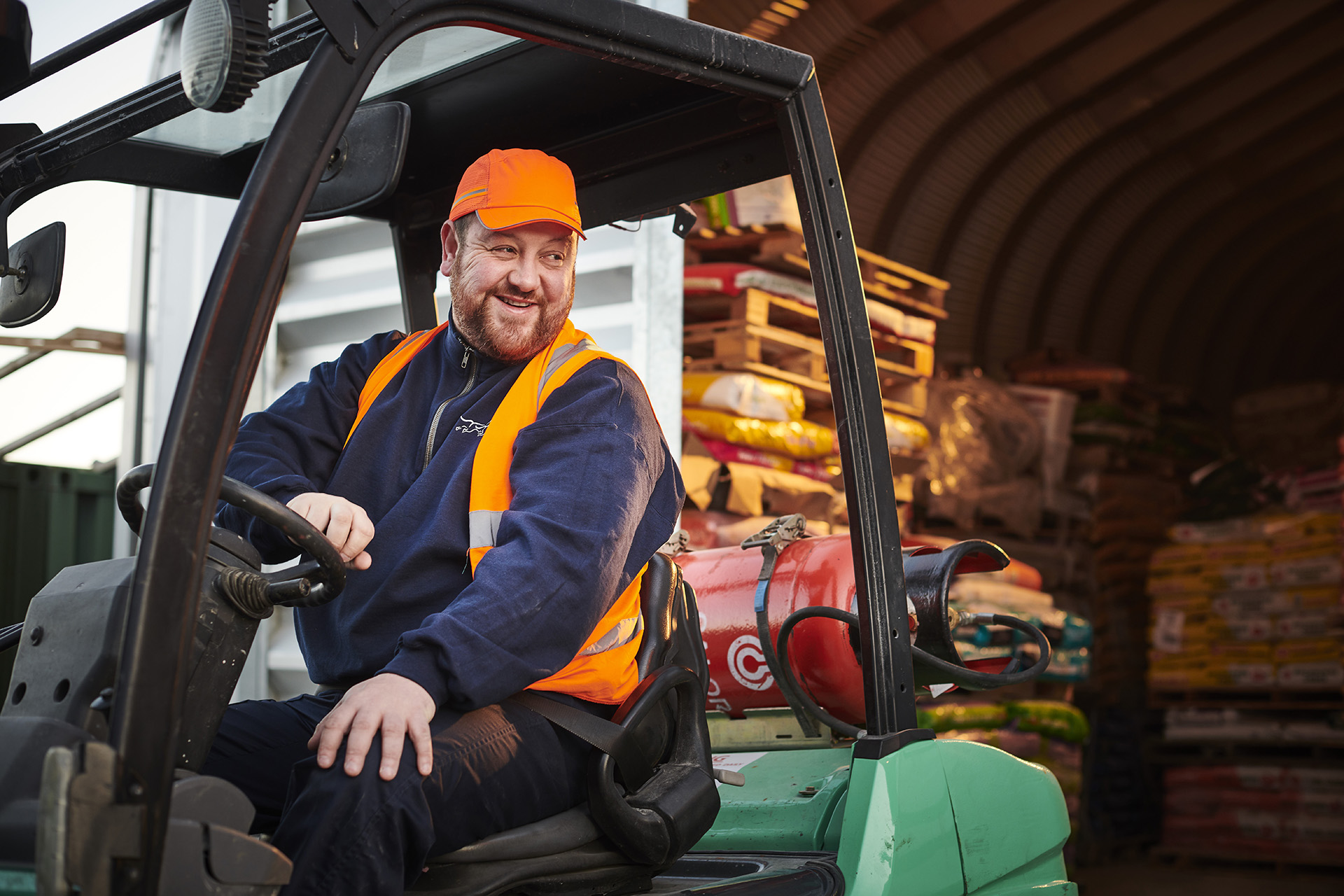A driver steering a Calor powered forklift truck