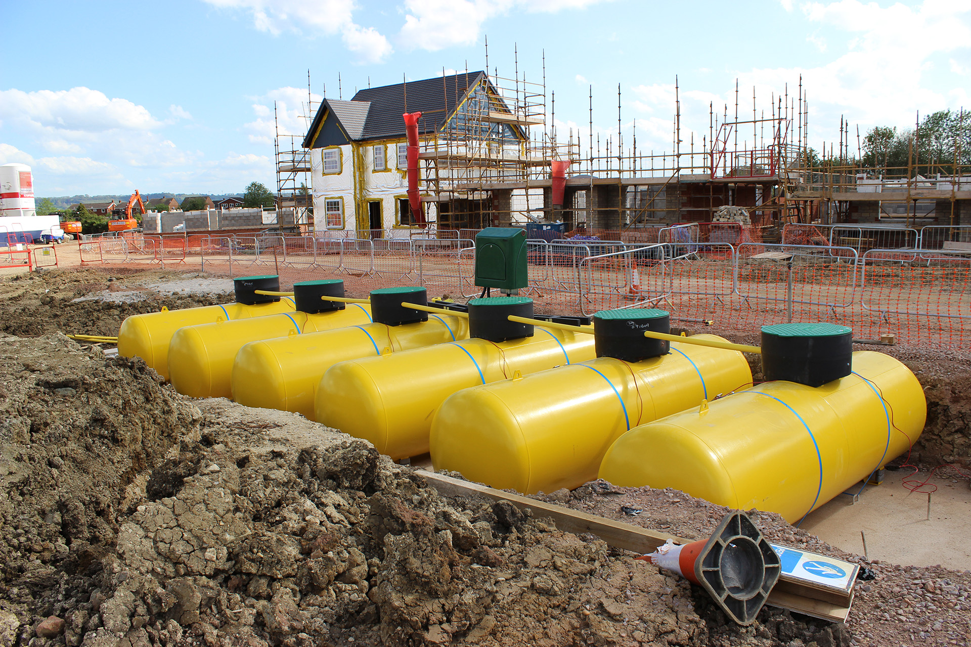 Several yellow LPG underground tanks in a row