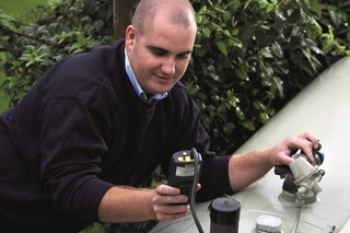 An LPG engineer carrying out a tightness test on a fixed bulk LPG installation