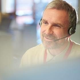 Man in an office with a headset