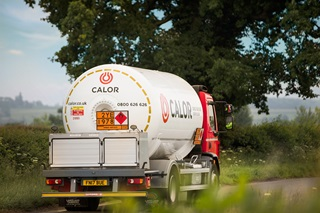 An angled rear view of a Calor lorry in a rural setting