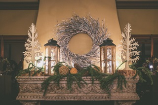 Christmas decorations on a fireplace in a rural home