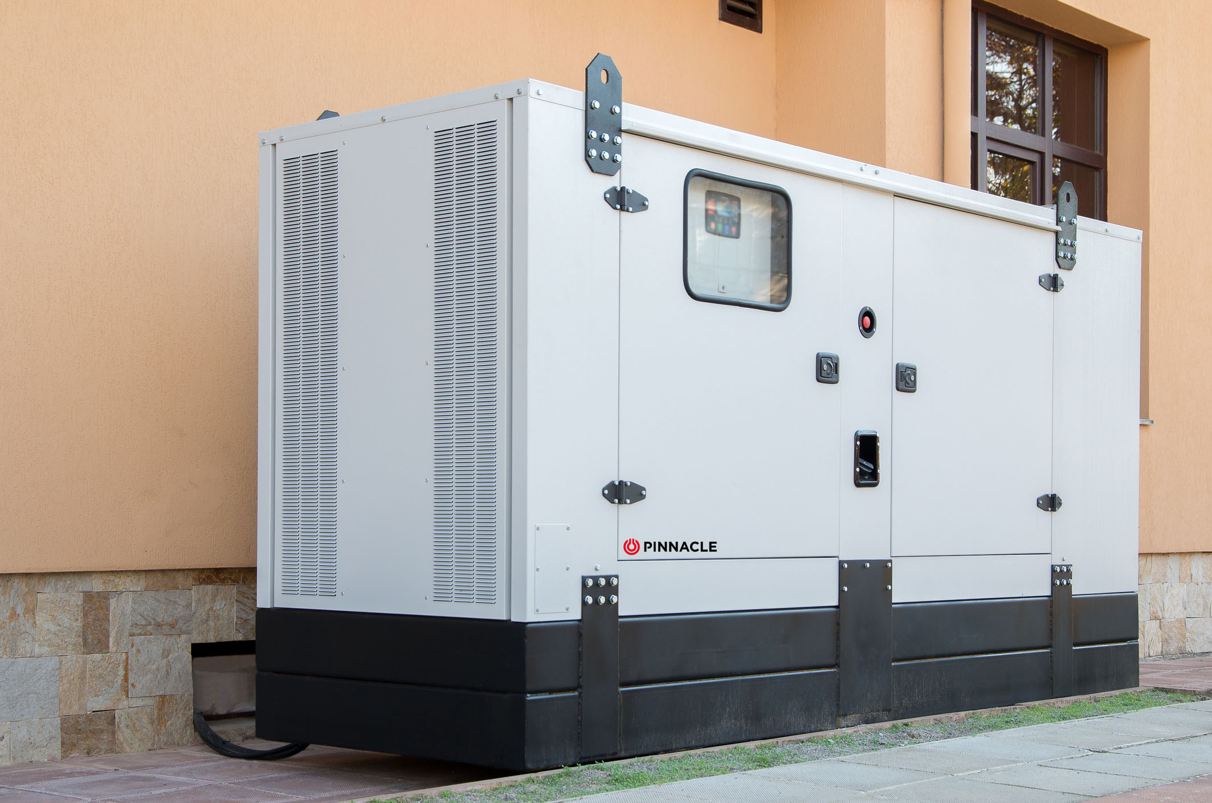 Large white generator outside of house